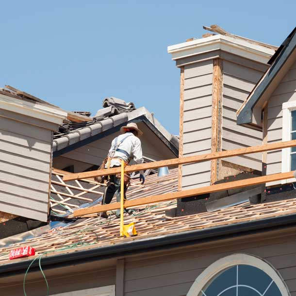 roofer on top of a house in Kelowna BC